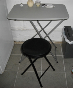 Folding table and stool. Great for tight spots or hide them away.